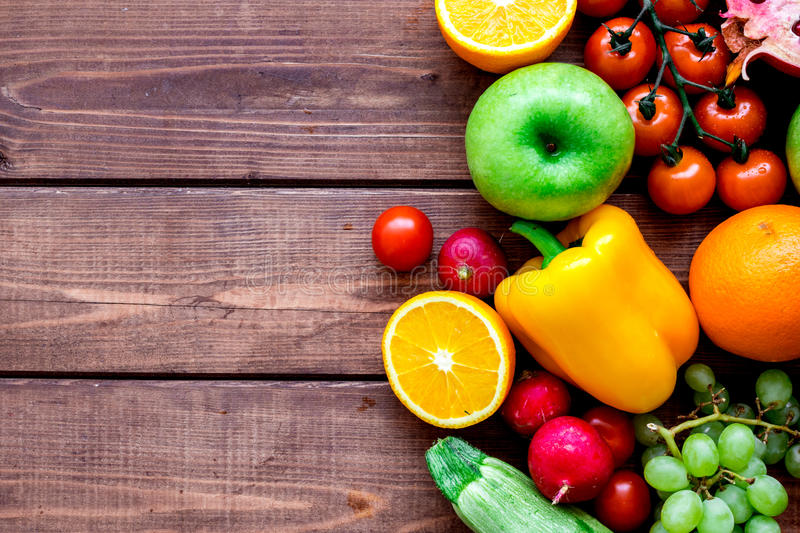 Summer food with fresh fruits and vegetables top view space for text. Summer food with fresh fruits and vegetables on wooden background top view space for text stock photography