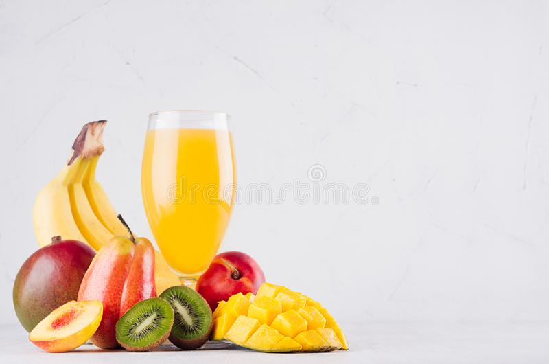 Summer fresh drink of tropical fruits with ripe sliced mango, kiwi and banana on white wood table, copy space. Summer fresh drink of tropical fruits with ripe stock images