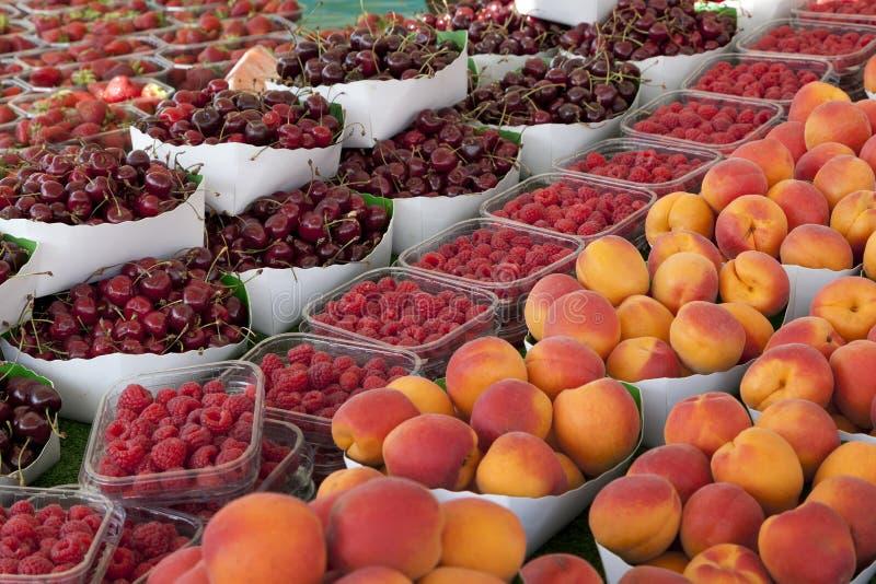 Summer fruit on the market. Fresh summer fruit on the market royalty free stock photos