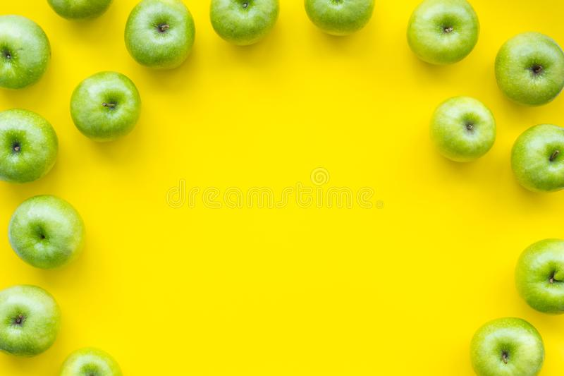 Summer fruit pattern with apples on yellow background top view copyspace. Summer organic fruit pattern with apples on yellow background top view copyspace stock photos