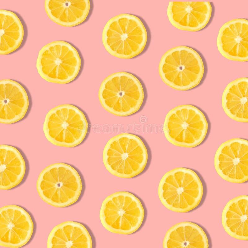 Lemon slice fruit pattern on a pastel pink background. Summer fruit pattern of lemon slices on a pastel pink background stock photo