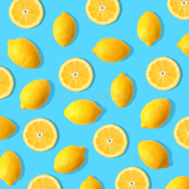 Lemon and lemon slice fruit pattern on a blue background. Summer fruit pattern of lemons and lemon slices on a blue background stock photos