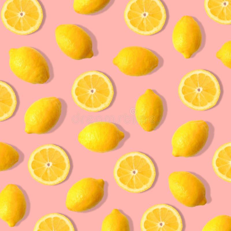 Lemon and lemon slice fruit pattern on a pastel pink background. Summer fruit pattern of lemons and lemon slices on a pastel pink background royalty free stock photos