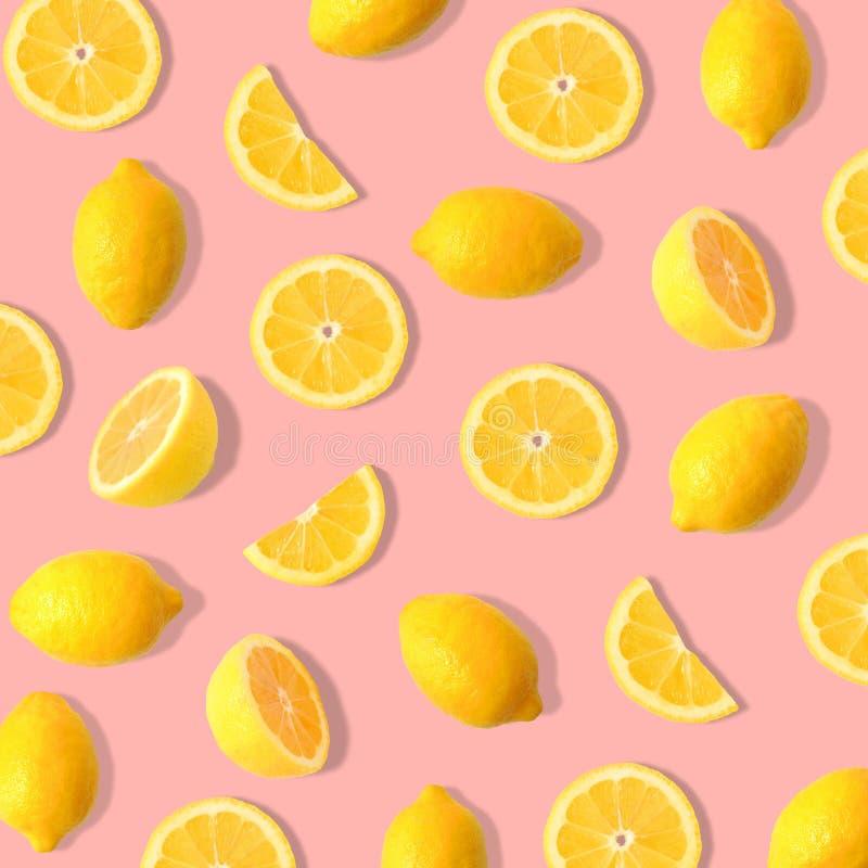 Lemon and lemon slice fruit pattern on a soft pink background. Summer fruit pattern of lemons and lemon slices on a soft pink background royalty free stock image