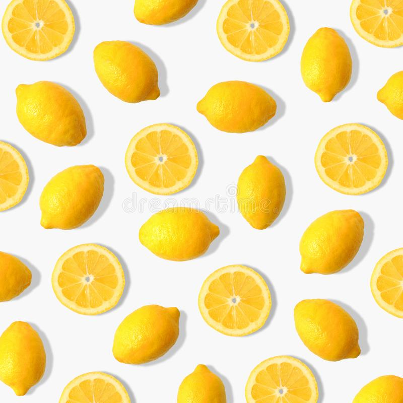 Lemon and lemon slice fruit pattern on a white background. Summer fruit pattern of lemons and lemon slices on a white background royalty free stock photography