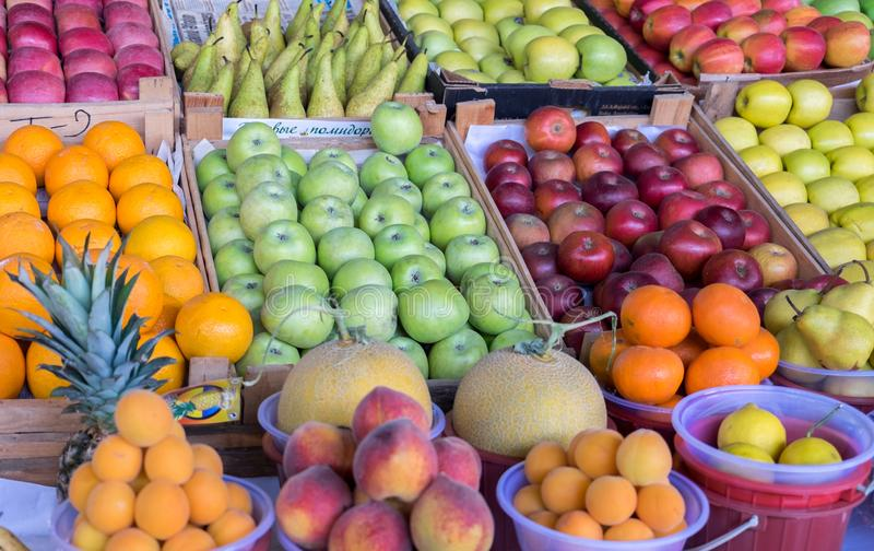 Summer fruits- apples, tangerines, melons, pineapples, peaches royalty free stock photography
