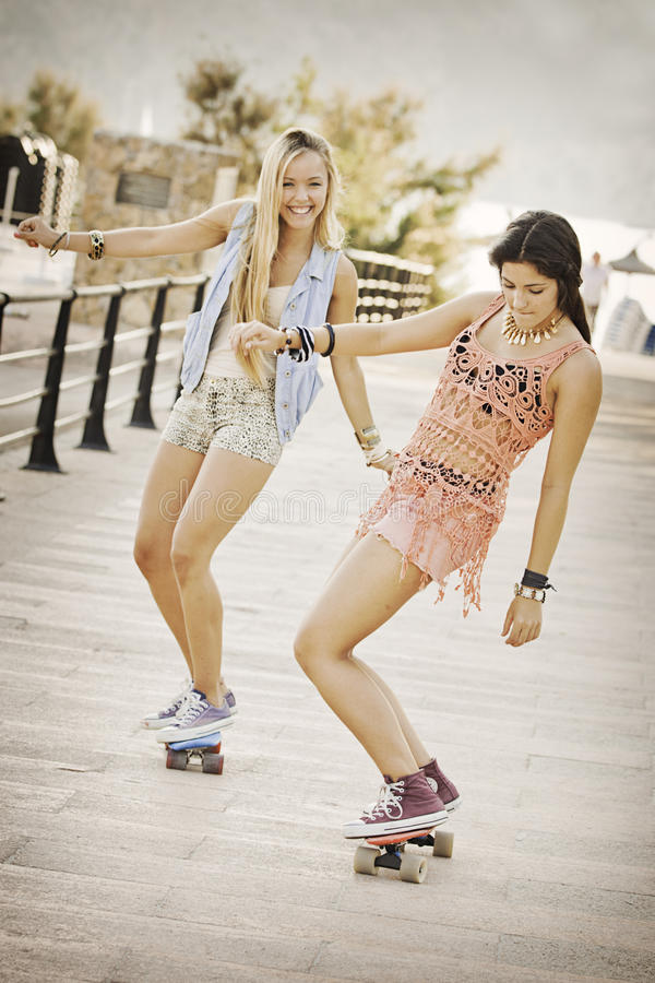 Summer fun. Healthy girls with skateboards royalty free stock image