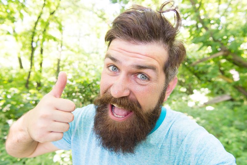 Summer fun. Bearded guy in park forest. Bearded hipster. Crazy bearded mature man in natural environment. Brutal male. Leisure. Hipster with long beard stock images