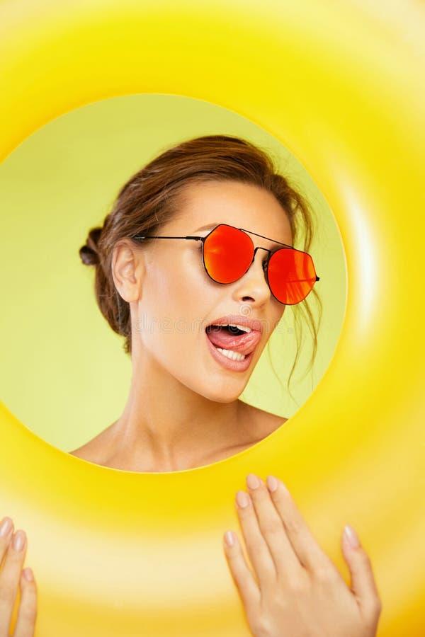 Summer Fun. Beautiful Woman Wearing Sunglasses. stock photography
