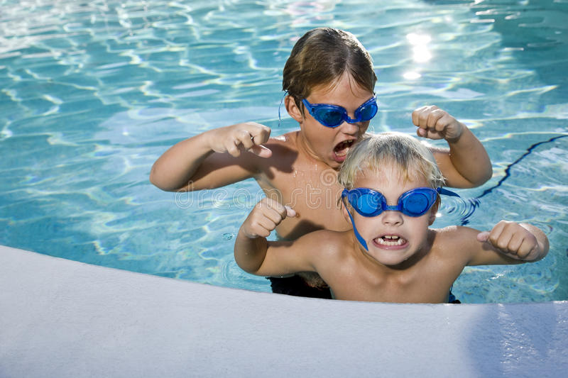 Summer Fun, Boys Playing In Swimming Pool Stock Photo