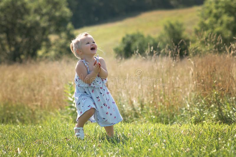 Summer Fun, child dancing and laughing! stock photography