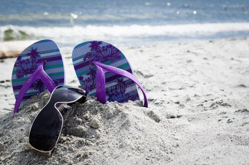 Summer Fun. Flip Flops and Sunglasses on Beach stock photos