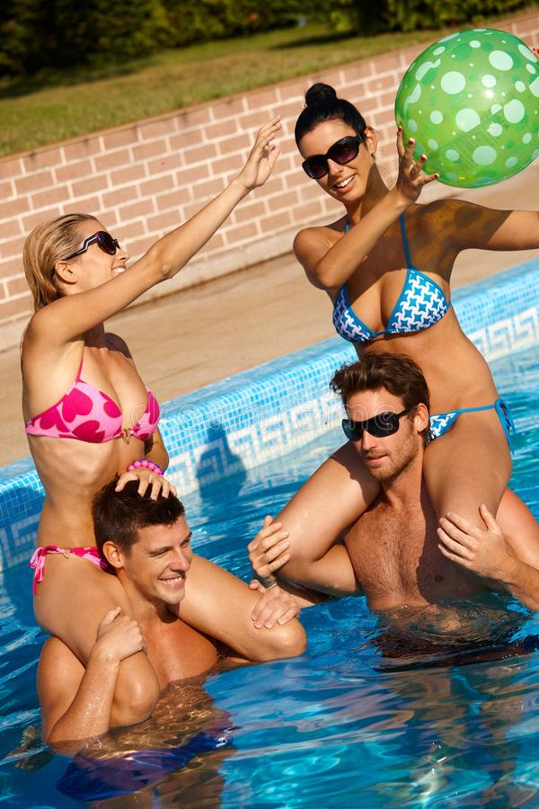 Download Summer fun in pool stock image. Image of companionship - 24192259