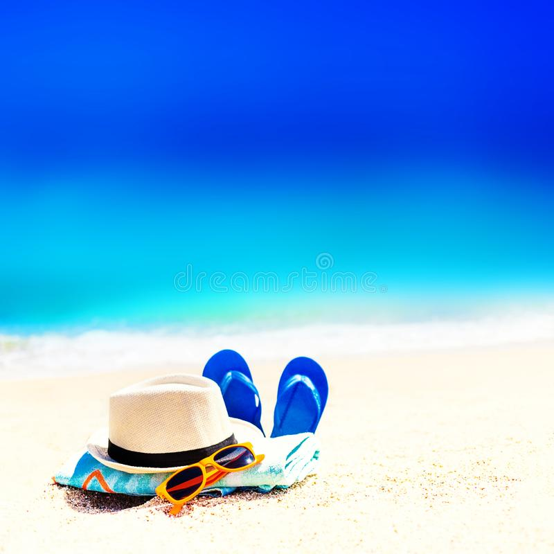 Summer fun time and accessories on a sand on the beach. Blue sa stock photo