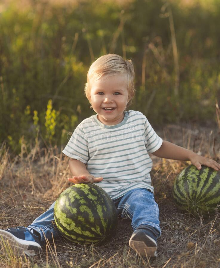 Free Summer Fun Vacation Of Little Cute Boy With Watermelon Stock Photography - 216780962