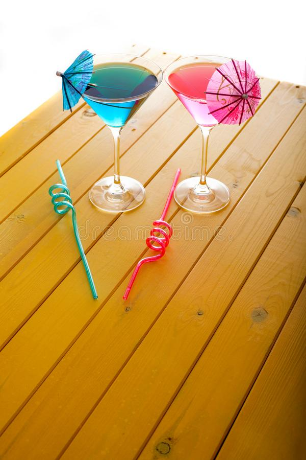 Summer fun vacation. Pink and blue beach party cocktail drinks. stock photos