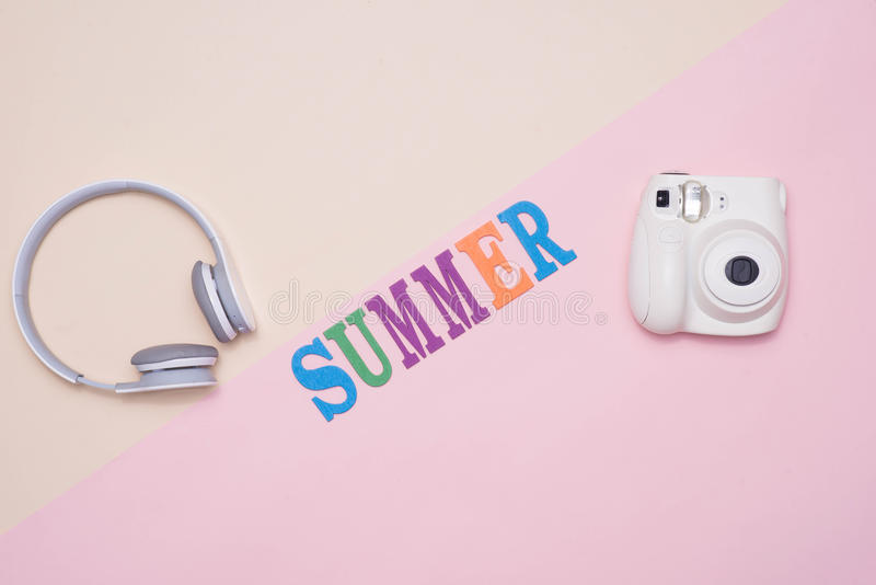 Summer fun written in colorful wooden letters on pastel color ba stock images