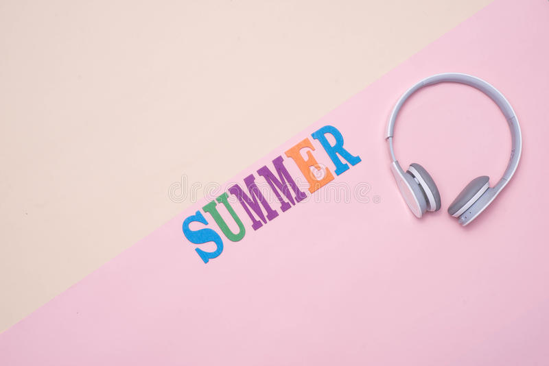 Summer fun written in colorful wooden letters on pastel color ba royalty free stock image