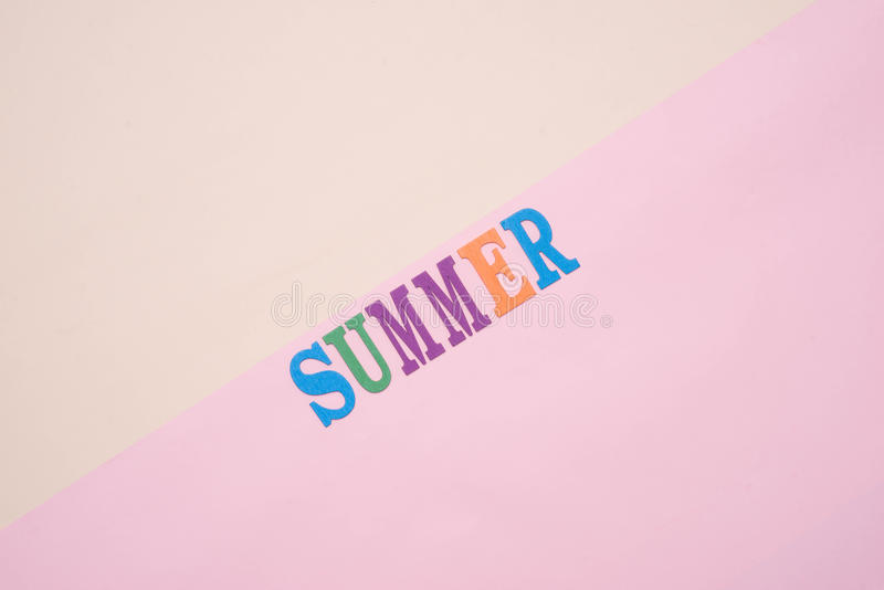 Summer fun written in colorful wooden letters on pastel color ba stock photo