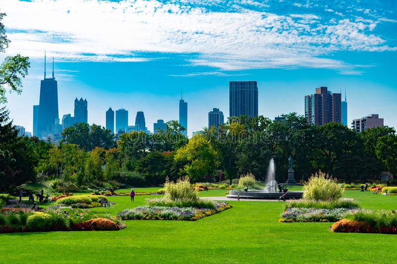 Summer Garden Scene in Lincoln Park Chicago with the Skyline. A summer garden scene with a field with flowers and a fountain with the Chicago skyline in the royalty free stock photos