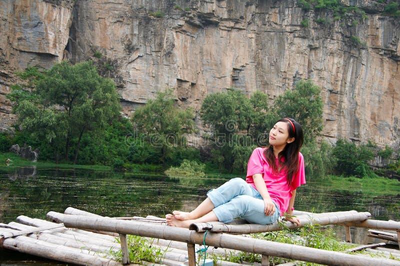 Summer Girl On The Bamboo Raft Stock Image