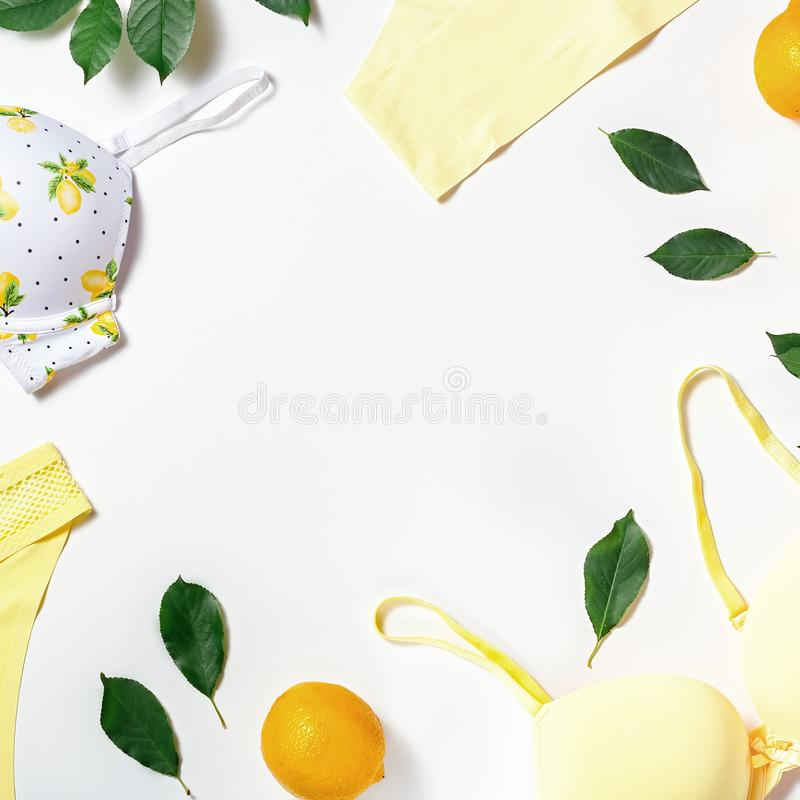 Summer girl cotton lingerie with lemons on white background, copy space. Flat lay, top view. Summer fashion concept royalty free stock photography