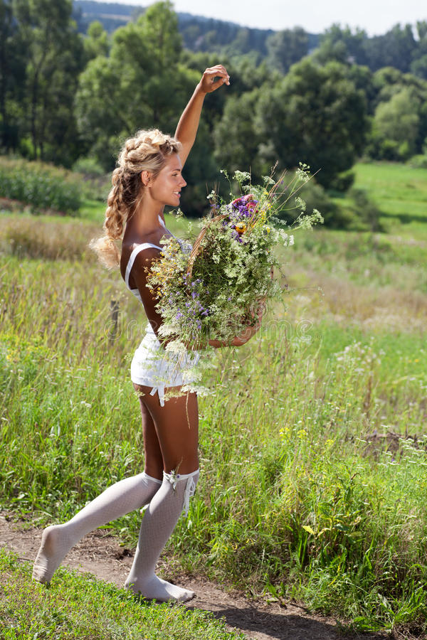 Summer girl with flowers in white dress stock image