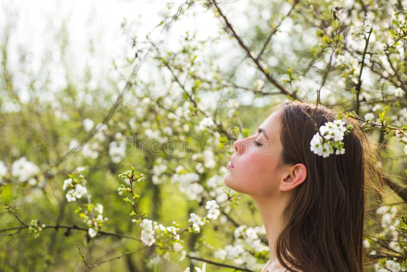 Summer girl with long hair. blossom. Spring woman. Springtime and vacation. Natural beauty and spa therapy. Woman with royalty free stock photography