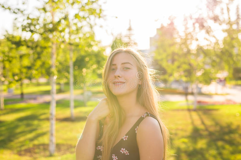 Summer girl portrait. Happy woman smiling on sunny summer or spring day outside in park. Pretty Caucasian woman outdoors.  royalty free stock photo