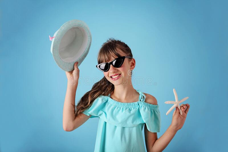 Summer girl. Smiling cute girl in sunglasses in the studio royalty free stock photos
