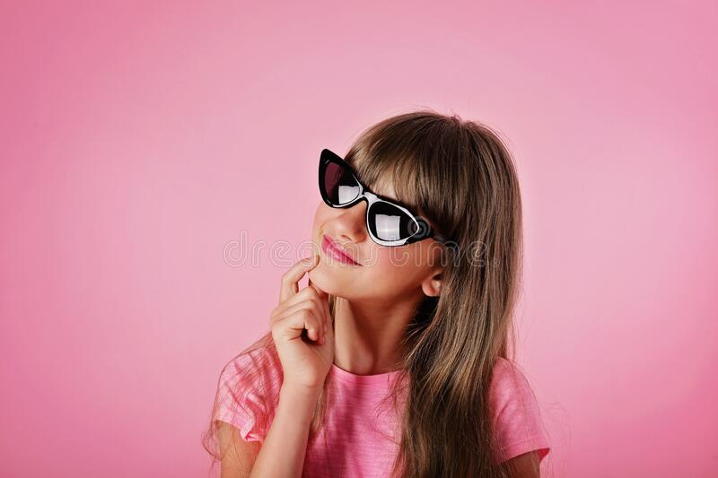 Summer girl in sunglasses in the studio stock images