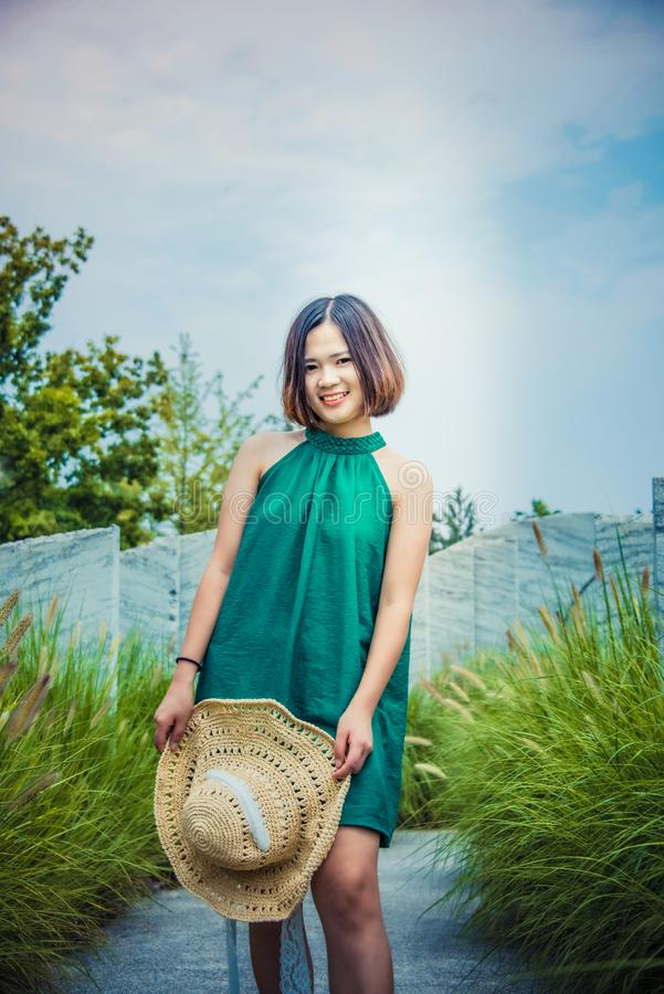A girl with a straw hat in her hand stock photos
