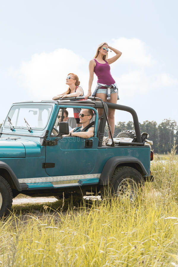 Summer girls having car trip royalty free stock image