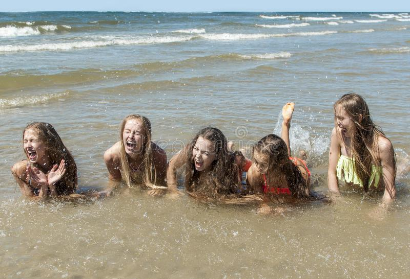 Summer girls playing in sea royalty free stock images
