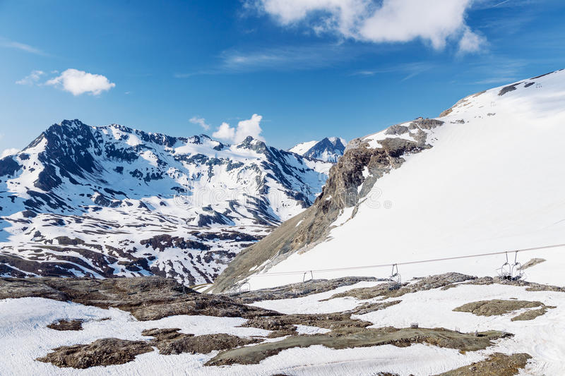 Summer on the glacier. Grand Motte glacier, chair lift and the surrounding mountains in summer. Tignes, French Alps royalty free stock photography