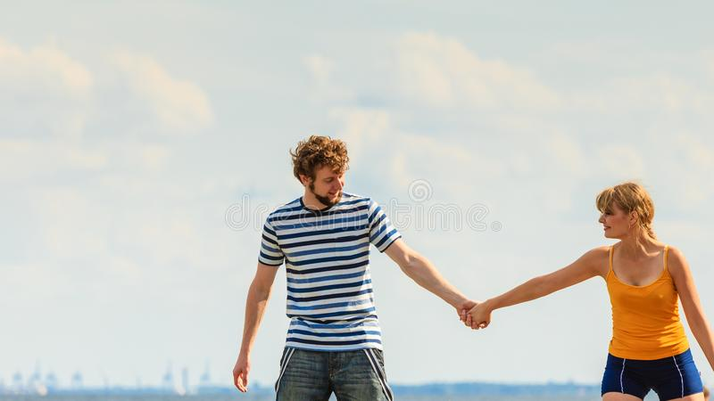 Young couple in love playing having fun outdoor. Summer happiness concept. Woman and men young couple in love playing sharing free time having fun outdoor sky royalty free stock photos