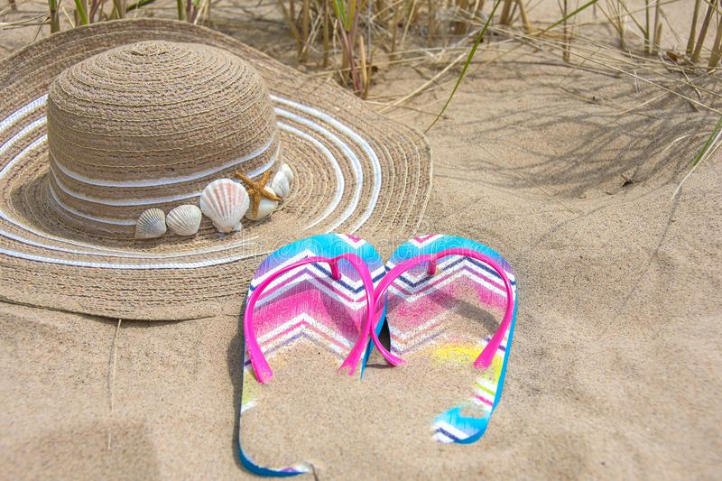 Summer hat and flip-flops royalty free stock images