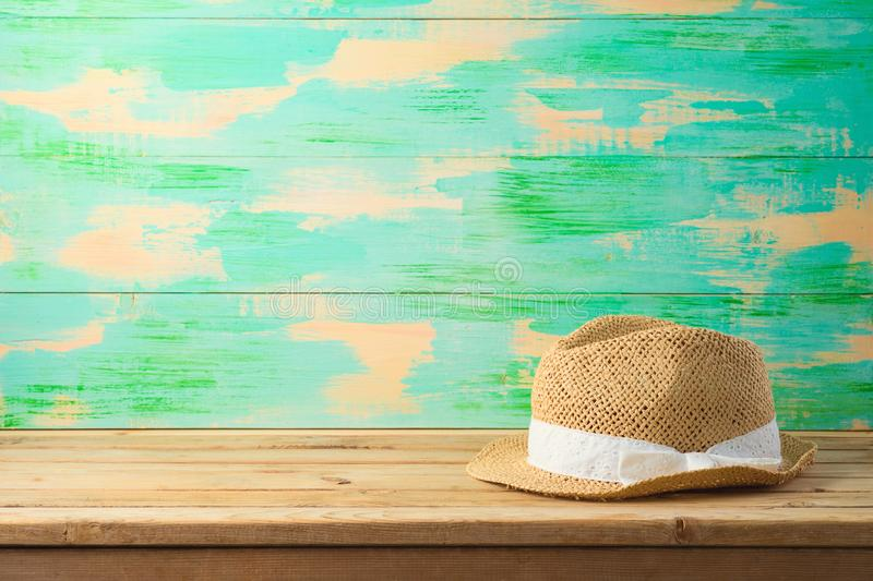 Summer hat on wooden table. Travel and tourism concept background stock images
