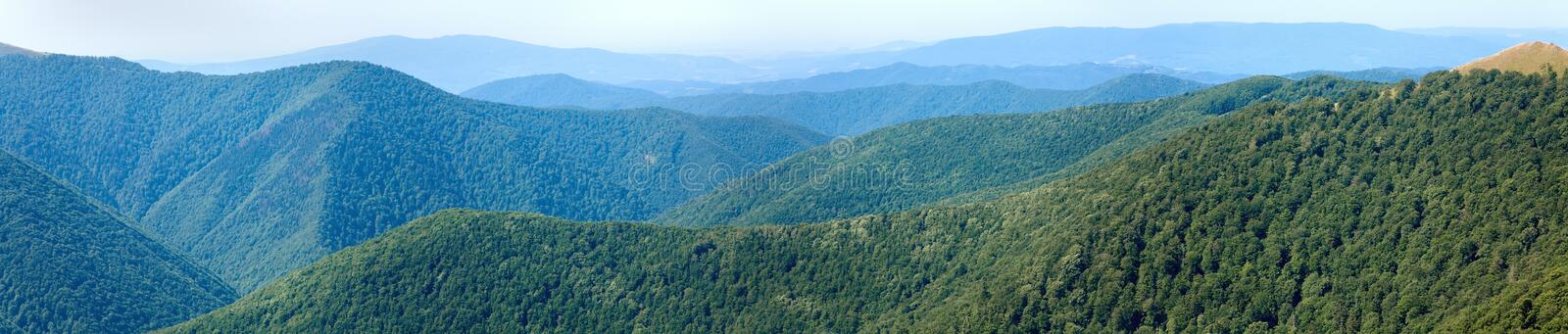 Summer hazy mountain forest panorama stock images