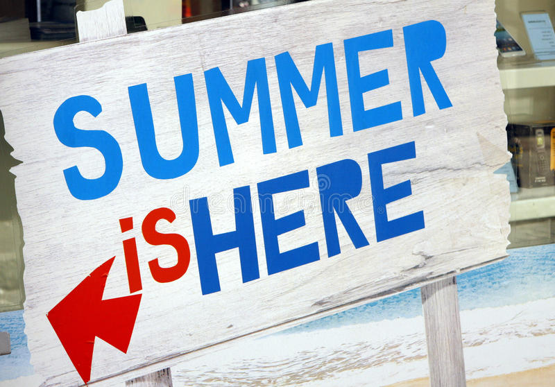 Summer is here. A wood sign with the inscription: summer is here royalty free stock image