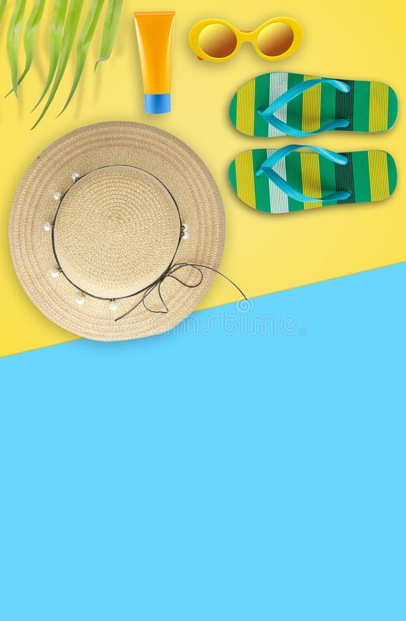 Summer holiday background, Beach accessories, Vacation and travel items. Flipflop, Sun glassed, Straw hat and Sunblock on yellow stock photography