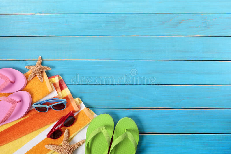 Summer holiday background border, flip flops, sunglasses, copy space royalty free stock photo