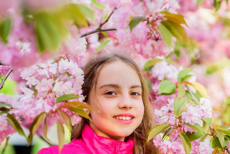 Summer holiday. Childhood beauty. skincare spa. Natural cosmetics for skin. small girl in spring flower bloom. blossom stock images