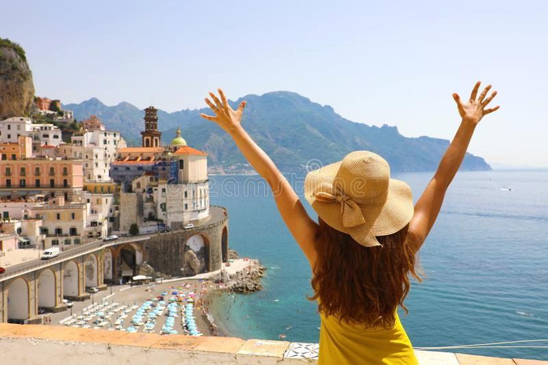 Summer holiday in Italy. Back view of young woman with straw hat royalty free stock image