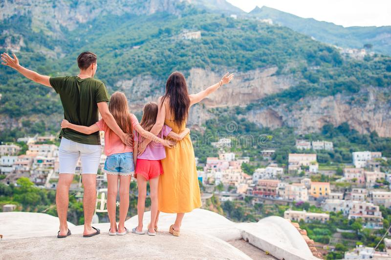 Summer holiday in Italy. Young woman in Positano village on the background, Amalfi Coast, Italy royalty free stock photos