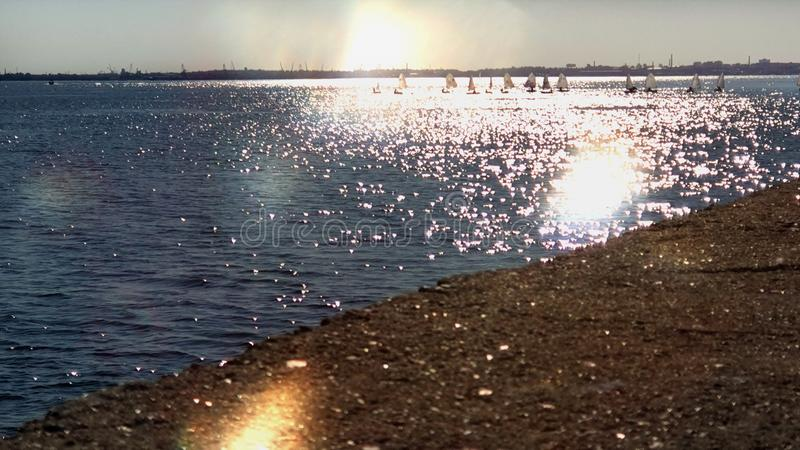 Summer Holiday Seascape Sunset  exotic  sea beach in Harbor water wave reflection skyscape Tallinn  panorama horizon stone   l stock image