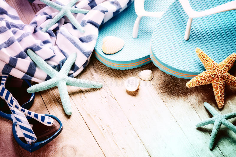 Summer holiday setting with flip flops and beach wear. Copy space royalty free stock image