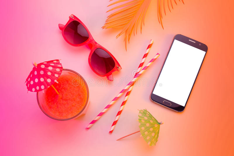 Summer holiday - smartphone, sunglasses and drink royalty free stock images