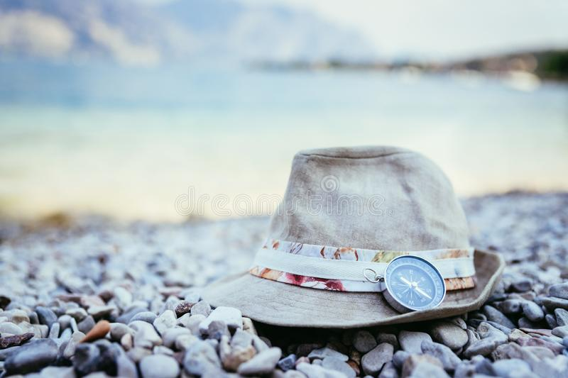 Summer holiday vacation accessories on beach, Italy. Holiday travel summer explore adventure free time trip compass beach sand vacation scene landscape accessory royalty free stock photography
