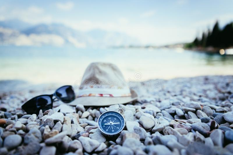 Summer holiday vacation accessories on beach, Italy. Holiday travel summer explore adventure free time trip compass sun glasses beach sand vacation accessory royalty free stock photos